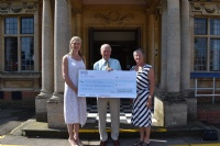CNS present cheque in memory of Paul Fisher